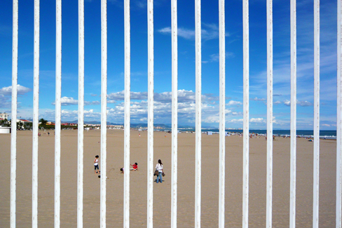behind the bars is the sea